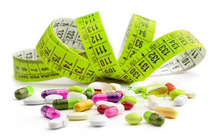 diet-pill-tape-measure