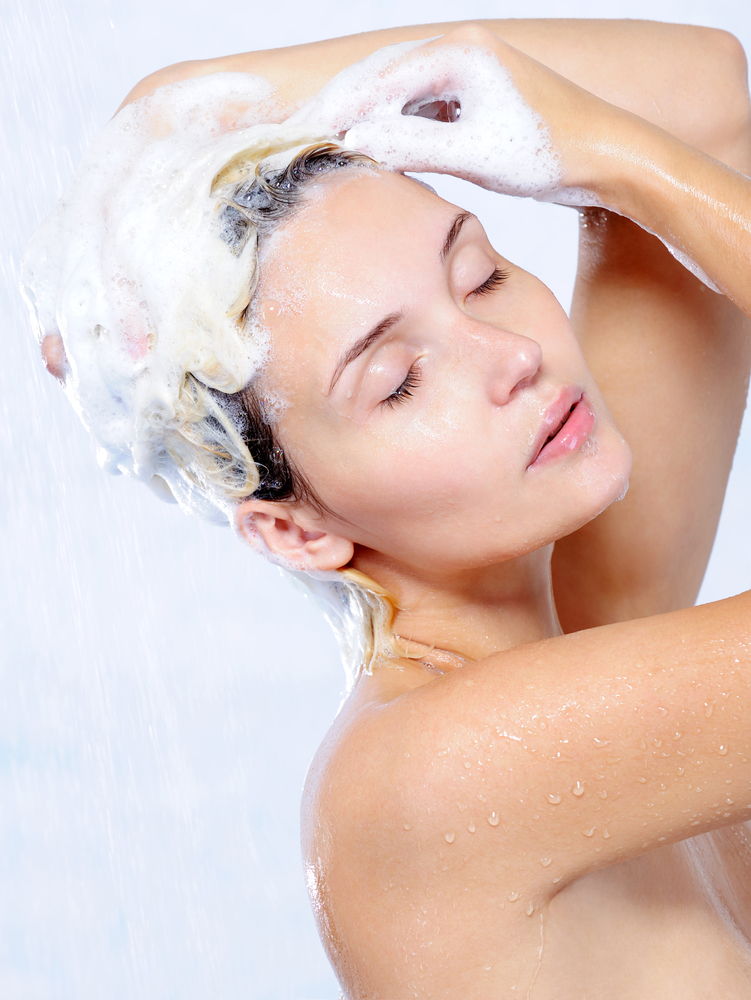 Beautiful woman washing head