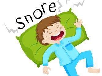 Boy in bed snoring