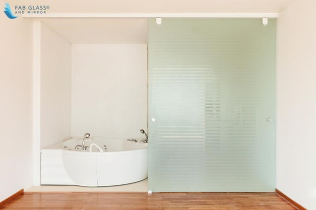Place a Partitioned Glass Enclosure to Hide Your Bathroom's Functional Area