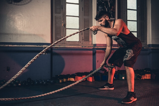 Man-exercising-with-ropes